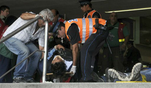 "<div class=""meta ""><span class=""caption-text "">A policeman helps carry a wounded passenger from a commuter train after a collision in Buenos Aires, Argentina, Wednesday Feb. 22, 2012. A packed train slammed into the end of the line in Buenos Aires' busy Once station Wednesday, killing dozens and injuring hundreds, according to police. (AP Photo/Leonardo Zavattaro,Telam) (AP Photo/ Leonardo Zavattaro)</span></div>"