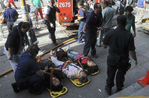 "<div class=""meta ""><span class=""caption-text "">Injured passengers from a commuter train wait to be carried away after a collision in Buenos Aires, Argentina, Wednesday Feb. 22, 2012.  A packed train slammed into the end of the line in Buenos Aires' busy Once station Wednesday, killing dozens and injuring hundreds, according to police. (AP Photo/Leonardo Zavattaro,Telam) (AP Photo/ Leonardo Zavattaro)</span></div>"