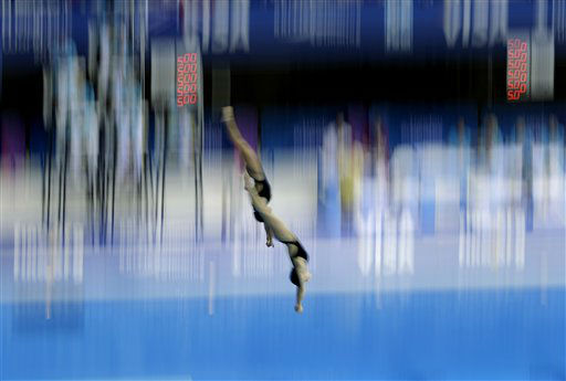 Romania&#39;s Mara Elena Aiacoboae and Adina Maria Topolinschi perform a dive during the semifinal of the women&#39;s synchronised 10m platform during the Diving World Cup event at the London 2012 Olympic Aquatics Centre at the Olympic Park in London, Wednesday, Feb. 22, 2012.  &#40;AP Photo&#47;Matt Dunham&#41; <span class=meta>(AP Photo&#47; Matt Dunham)</span>