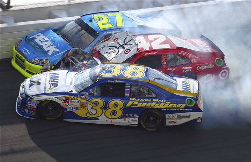 David Gilliand &#40;38&#41;, Juan Pablo Montoya &#40;42&#41;, of Colombia, and Paul Menard &#40;27&#41; crash during the first of two NASCAR Daytona Duel 150 qualifying auto races in Daytona Beach, Fla., Thursday, Feb. 23, 2012. &#40;AP Photo&#47;John Moore&#41; <span class=meta>(AP Photo&#47; John Moore)</span>
