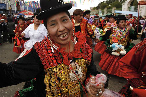 A reveler poses for pictures as she parades during carnival celebrations in La Paz, Bolivia, Sunday, Feb. 26, 2012.  &#40;AP Photo&#47;Juan Karita&#41; <span class=meta>(AP Photo&#47; Juan Karita)</span>