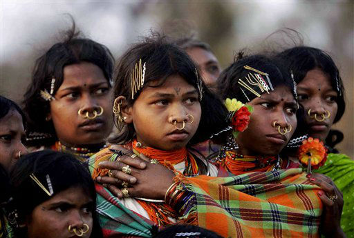 In this photo taken Sunday, Feb. 26, 2012, Indian Dongaria Kondh tribal girls watch sacrifice rituals during the annual festival of Niyam Raja in Lanjigarh at the sacred Niyamgiri Hill, about 400 kilometers &#40;249 miles&#41; from the eastern Indian city of Bhubaneswar, Orissa, India. In August 2010 India refused permission to London-based Vedanta Resources to mine bauxite for its alumina refinery in the Niyamgiri Hills citing violations of environmental and human rights laws. The courts are expected to hear the company&#39;s appeal later this year. &#40;AP Photo&#47;Biswaranjan Rout&#41; <span class=meta>(AP Photo&#47; Biswaranjan Rout)</span>
