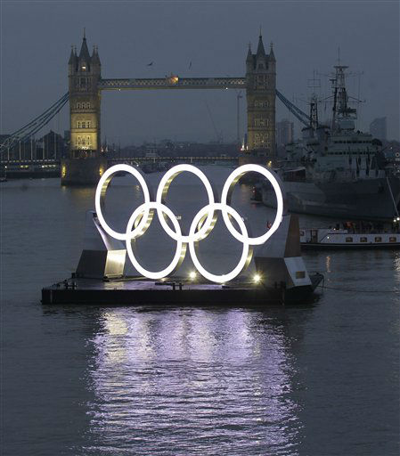 Backdropped by the historic Tower Bridge, a giant Olympic Rings floats on the River Thames in London in the run-up for the Olympic games, during its launch to mark 150-days until the start of the London 2012 Olympic games, Tuesday, Feb. 28, 2012.  The museum warship ship HMS Belfast battleship, at right. &#40;AP Photo&#47;Sang Tan&#41; <span class=meta>(AP Photo&#47; Sang Tan)</span>
