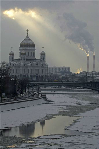 The sun shines through the clouds during a gloomy day in Moscow with the view of Moskva river and the Christ the Saviour Cathedral, in Russia, Tuesday, Feb. 28, 2012. &#40;AP Photo&#47;Mikhail Metzel&#41; <span class=meta>(AP Photo&#47; Mikhail Metzel)</span>