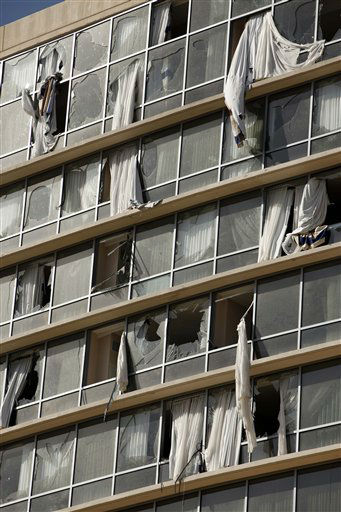 Curtains billow out of shattered windows at a Hilton hotel in downtown Branson, Mo., Wednesday, Feb. 29, 2012. A powerful storm system  lashed the Midwest early Wednesday, roughing up the country music resort city of Branson and laying waste to a small town in Kansas. &#40;AP Photo&#47;Mark Schiefelbein&#41; <span class=meta>(AP Photo&#47; Mark Schiefelbein)</span>