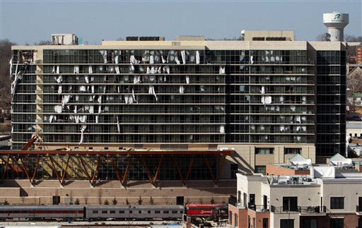 "<div class=""meta ""><span class=""caption-text "">Windows are blown out of a Hilton hotel in downtown Branson, Mo., Wednesday, Feb. 29, 2012. A powerful storm system  lashed the Midwest early Wednesday, roughing up the country music resort city of Branson and laying waste to a small town in Kansas. (AP Photo/Mark Schiefelbein) (AP Photo/ Mark Schiefelbein)</span></div>"
