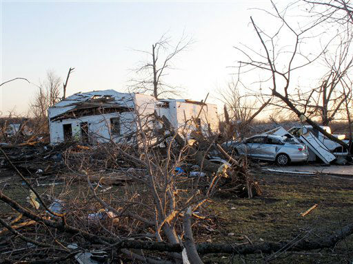 A tornado-damaged home sits amid debris along Main Street, Wednesday, Feb. 29, 2012, in Harveyville, Kan. The small eastern Kansas town of Harveyville took a direct hit from an apparent tornado late Tuesday, injuring 11 people and reducing much of the town to ruins. Authorities say at least 12 people were injured. &#40;AP Photo&#47;John Hanna&#41; <span class=meta>(AP Photo&#47; John Hanna)</span>