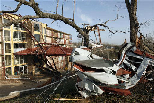 Metal debris is wrapped around trees and windows are shattered at the Ozark Mountain Inn in Branson, Mo, Wednesday, Feb. 29, 2012.  A powerful storm system  lashed the Midwest early Wednesday, roughing up the country music resort city of Branson and laying waste to a small town in Kansas. &#40;AP Photo&#47;Mark Schiefelbein&#41; <span class=meta>(AP Photo&#47; Mark Schiefelbein)</span>