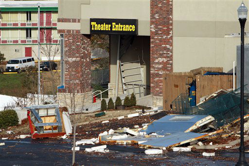 Storm debris is piled near the entrance to the Dick Clark&#39;s American Bandstand Theater in Branson, Mo, Wednesday, Feb.  29, 2012. A powerful storm system  lashed the Midwest early Wednesday, roughing up the country music resort city of Branson and laying waste to a small town in Kansas.&#40;AP Photo&#47;Mark Schiefelbein&#41; <span class=meta>(AP Photo&#47; Mark Schiefelbein)</span>