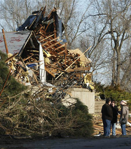 Residents talk in front of a home after severe storms destroyed several homes and businesses in Harveyville, Kan., Wednesday, Feb. 29, 2012. &#40;AP Photo&#47;Orlin Wagner&#41; <span class=meta>(AP Photo&#47; Orlin Wagner)</span>