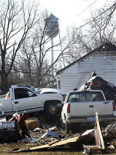 Damaged vehicles are piled together the morning after severe storms destroyed several homes and businesses in Harveyville, Kan., Wednesday, Feb. 29, 2012. A powerful storm system  lashed the Midwest early Wednesday, roughing up the country music resort city of Branson and laying waste to the small town in Kansas.&#40;AP Photo&#47;Orlin Wagner&#41; <span class=meta>(AP Photo&#47; Orlin Wagner)</span>