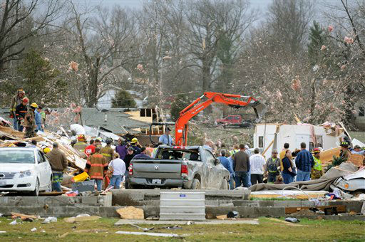 Emergency responders work to clear debris in a neighborhood in Harrisburg, Ill., after an early morning tornado Wednesday, Feb. 29, 2012. At least six people died in Harrisburg in the pre-dawn tornado.  &#40;AP Photo&#47;Stephen Lance Dennee&#41; <span class=meta>(AP Photo&#47; Stephen Lance Dennee)</span>
