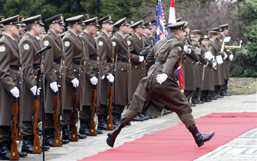 A member of the Croatian honor guards jumps over the red carped before the arrival ceremony for Austria&#39;s President Heinz Fischer, in Zagreb, Croatia, Thursday, March 1, 2012. President Fischer is on and official visit to Croatia. &#40;AP Photo&#47;Darko Bandic&#41; <span class=meta>(AP Photo&#47; Darko Bandic)</span>