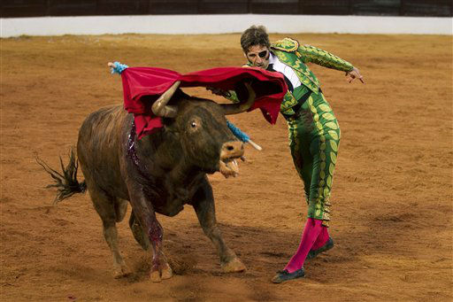"<div class=""meta ""><span class=""caption-text "">Spanish bullfighter Juan Jose Padilla performs during a bullfight in the southwestern Spanish town of Olivenza, Sunday, March 4, 2012. Padilla, who lost sight in one eye and has partial facial paralysis after a terrifying goring returned to the bullring Sunday, five months after his injury.  (AP Photo/Daniel Ochoa de Olza) (AP Photo/ Daniel Ochoa de Olza)</span></div>"