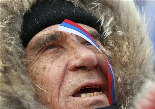 A supporter of Russian Prime Minister and presidential candidate Vladimir Putin attends a rally at the central Manezhnaya Square just outside the Kremlin in Moscow, Russia, Monday, March 5, 2012. &#40;AP Photo&#47;Sergei Grits&#41; <span class=meta>(AP Photo&#47; Sergei Grits)</span>