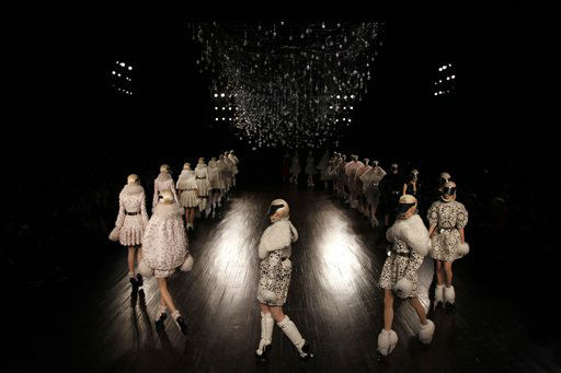 Models wear creations by British designer Sarah Burton for Alexander McQueen as part of the Fall-Winter, ready-to-wear 2013 fashion collection, during Paris Fashion week, Tuesday, March 6, 2012. &#40;AP Photo&#47;Christophe Ena&#41; <span class=meta>(AP Photo&#47; Christophe Ena)</span>