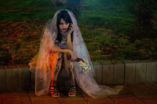 "<div class=""meta image-caption""><div class=""origin-logo origin-image ""><span></span></div><span class=""caption-text"">A woman wearing zombie make-up and a wedding dress sit and speaks on the phone while waiting for a friend to join the 2012 Zombie Walk during the Purim festival in Tel Aviv, Israel,Tuesday, March 6, 2012. About 250 participants matched in central Tel Aviv during the annual Zombie Walk. (AP Photo/Ariel Schalit) (AP Photo/ Ariel Schalit)</span></div>"
