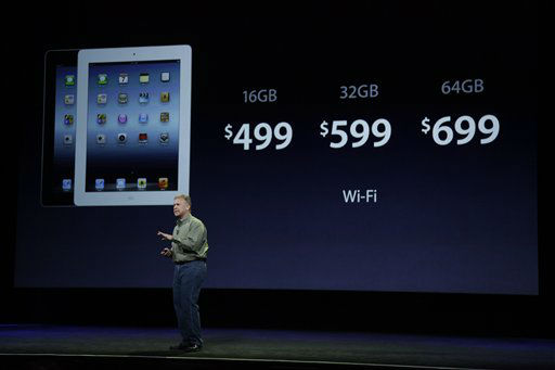 ADDS LAST NAME AND TITLE - Senior vice president of Worldwide Marketing Phil Schiller announces new pricing for new iPad during an Apple event in San Francisco, Wednesday, March 7, 2012.  The new iPad features a sharper screen and a faster processor.  Apple says the new display will be even sharper than the high-definition television set in the living room.  &#40;AP Photo&#47;Paul Sakuma&#41; <span class=meta>(AP Photo&#47; Paul Sakuma)</span>