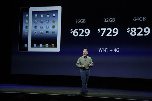 Apple&#39;s senior vice president of Worldwide Marketing Phil Schiller discuss the prices of the new iPad during an event in San Francisco, Wednesday, March 7, 2012.  The new iPad features a sharper screen and a faster processor.  Apple says the new display will be even sharper than the high-definition television set in the living room. &#40;AP Photo&#47;Paul Sakuma&#41; <span class=meta>(AP Photo&#47; Paul Sakuma)</span>