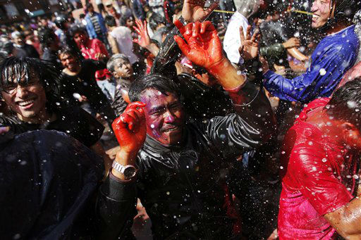 Nepalese people with their faces smeared with color dance as they celebrate Holi, the festival of colors, in Katmandu, Nepal, Wednesday, March 7, 2012. The festival also marks the coming of spring. &#40;AP Photo&#47;Niranjan Shrestha&#41; <span class=meta>(AP Photo&#47; Niranjan Shrestha)</span>