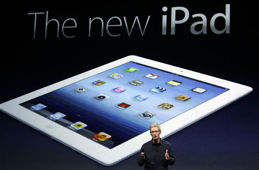 Apple CEO Tim Cook introduces the new iPad during an event in San Francisco, Wednesday, March 7, 2012.  The new iPad features a sharper screen and a faster processor.  Apple says the new display will be even sharper than the high-definition television set in the living room. &#40;AP Photo&#47;Paul Sakuma&#41; <span class=meta>(AP Photo&#47; Paul Sakuma)</span>
