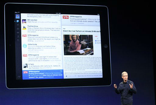 Apple CEO Tim Cook introduces the new iPad during an event in San Francisco, Wednesday, March 7, 2012.  The new iPad features a sharper screen and a faster processor.  Apple says the new display will be even sharper than the high-definition television set in the living room. &#40;AP Photo&#47;Jeff Chiu&#41; <span class=meta>(AP Photo&#47; Jeff Chiu)</span>