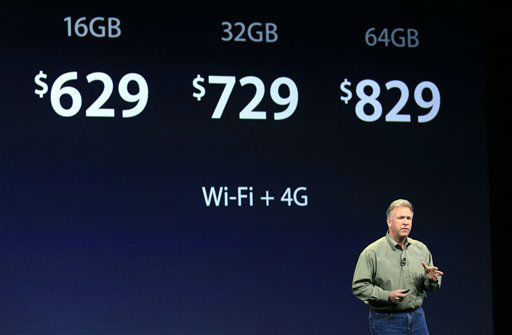 "<div class=""meta ""><span class=""caption-text "">Apple's senior vice president of Worldwide Marketing Phil Schiller discuss the prices of the new iPad during an event in San Francisco, Wednesday, March 7, 2012.  The new iPad features a sharper screen and a faster processor.  Apple says the new display will be even sharper than the high-definition television set in the living room. (AP Photo/Jeff Chiu) (AP Photo/ Jeff Chiu)</span></div>"