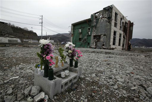 Flowers and water are offered on a makeshift altar in a vacant land next to a damaged building in a neighborhood destroyed by the March 11 earthquake and tsunami in Onagawa, Miyagi Prefecture, Friday, March 9, 2012, two days before the one-year anniversary of the disaster. &#40;AP Photo&#47;Shizuo Kambayashi&#41; <span class=meta>(AP Photo&#47; Shizuo Kambayashi)</span>