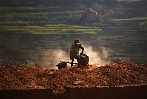 "<div class=""meta ""><span class=""caption-text "">A Nepalese man works at a brick factory in Bungmati on the outskirts of Katmandu, Nepal, Monday, March 12, 2012. (AP Photo/Niranjan Shrestha) (AP Photo/ Niranjan Shrestha)</span></div>"