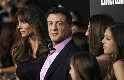 "<div class=""meta image-caption""><div class=""origin-logo origin-image ""><span></span></div><span class=""caption-text"">Jennifer Flavin, left, and Sylvester Stallone arrive at the world premiere of ""The Hunger Games"" on Monday March 12, 2012 in Los Angeles. (AP Photo/Matt Sayles) (AP Photo/ Matt Sayles)</span></div>"