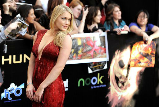 "<div class=""meta image-caption""><div class=""origin-logo origin-image ""><span></span></div><span class=""caption-text"">Leven Rambin arrives at the world premiere of ""The Hunger Games"" on Monday March 12, 2012 in Los Angeles. (AP Photo/Chris Pizzello) (AP Photo/ Chris Pizzello)</span></div>"
