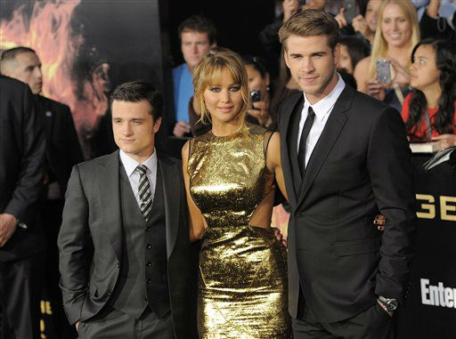 "<div class=""meta image-caption""><div class=""origin-logo origin-image ""><span></span></div><span class=""caption-text"">From left, Josh Hutcherson, Jennifer Lawrence and Liam Hemsworth arrive at the world premiere of ""The Hunger Games"" on Monday March 12, 2012 in Los Angeles. (AP Photo/Chris Pizzello) (AP Photo/ Chris Pizzello)</span></div>"