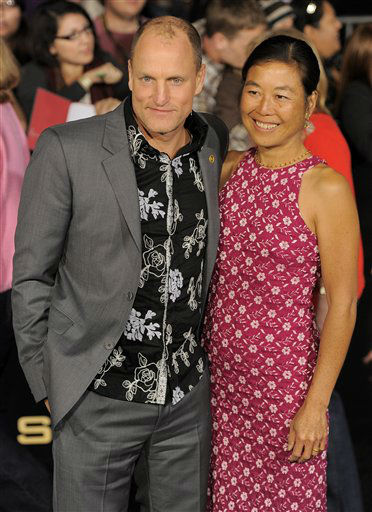 Woody Harrelson, left, and Laura Louie arrive at the world premiere of &#34;The Hunger Games&#34; on Monday March 12, 2012 in Los Angeles. &#40;AP Photo&#47;Chris Pizzello&#41; <span class=meta>(AP Photo&#47; Chris Pizzello)</span>