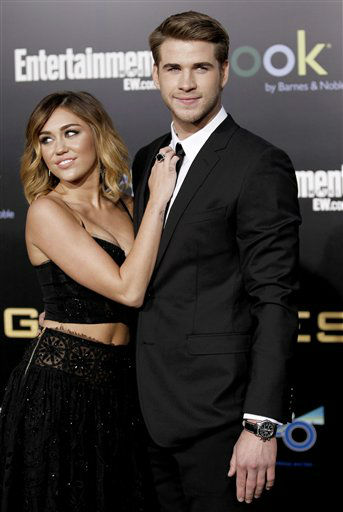 "<div class=""meta ""><span class=""caption-text "">Liam Hemsworth, right, and Miley Cyrus arrive at the world premiere of ""The Hunger Games"" on Monday March 12, 2012 in Los Angeles. (AP Photo/Matt Sayles) (AP Photo/ Matt Sayles)</span></div>"
