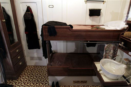 "<div class=""meta image-caption""><div class=""origin-logo origin-image ""><span></span></div><span class=""caption-text"">In this photo of Tuesday March 13, 2012 a replica of 2nd class cabin in the Titanic Ship is on display in the new 100 million British pounds ($157 million)Titanic Belfast Visitor's Center.  Celebrating the ship and the people who built her is the aim of Titanic Belfast, a shiny new ""visitor experience"" _ don't call it a museum _ whose four prow-like wings jut jauntily skyward beside the River Lagan on the site of the old Harland and Wolff shipyard. Titanic, the world's largest, most luxurious ocean liner, left Belfast on April 2, 1912 8 days before its maiden voyage from England to New York. Twelve days later, it struck an iceberg off the coast of Newfoundland and sank in the early hours of April 15.  More than 1,500 of the 2,200 people on board died. (AP Photo/Peter Morrison) (AP Photo/ Peter Morrison)</span></div>"