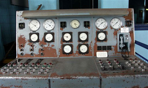 "<div class=""meta image-caption""><div class=""origin-logo origin-image ""><span></span></div><span class=""caption-text"">In this photo of Tuesday March 13, 2012, showing the controls of the old pump-house at Thompson Dock beside the new 100 million British pounds ($157 million)Titanic Belfast Visitor's Center. Celebrating the Titanic ship and the people who built her in the Titanic Belfast, with its four prow-like wings jutting jauntily skyward beside the River Lagan on the site of the old Harland and Wolff shipyard. Titanic, then the world's largest, most luxurious ocean liner, left Belfast on April 2, 1912 8 days before its maiden voyage from England to New York. Twelve days later, it struck an iceberg off the coast of Newfoundland and sank in the early hours of April 15, and more than 1,500 of the 2,200 people on board died. (AP Photo/Peter Morrison) (AP Photo/ Peter Morrison)</span></div>"