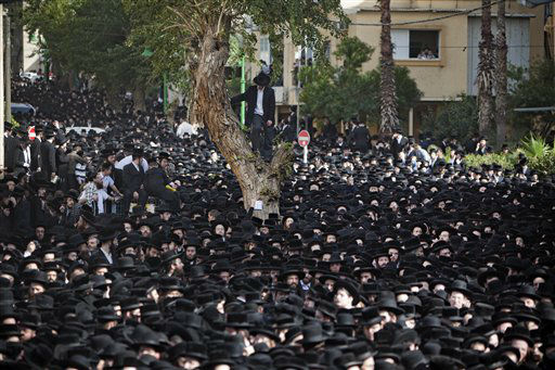 Ultra Orthodox Jews attend the funeral of Rabbi Moshe Yehoshua Hager, leader of the hassidic sect Vizhnitz in Israel, in Bnei Brak , Ultra Orthodox Jewish town near Tel Aviv, Israel, Wednesday, March 14, 2012. Rabbi Moshe Yehoshua Hager was 95.&#40;AP Photo&#47;Oded Balilty&#41; <span class=meta>(AP Photo&#47; Oded Balilty)</span>