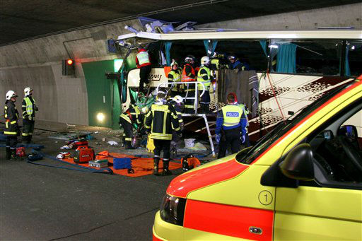 "<div class=""meta ""><span class=""caption-text "">Rescuers and police work amid the wreckage of a tourist bus from Belgium at the accident site in a tunnel of the A9 highway near Sierre, western Switzerland, early Wednesday, March 14, 2012. A bus carrying Belgian students returning from a ski holiday crashed into a wall in a Swiss tunnel, killing 22 Belgian 12-year-olds and six adults, police said Wednesday.  (AP Photo/KANTONSPOLIZEI WALLIS/POLICE OF VALAIS, Handout)  MANDATORY CREDIT (AP Photo/ Anonymous)</span></div>"