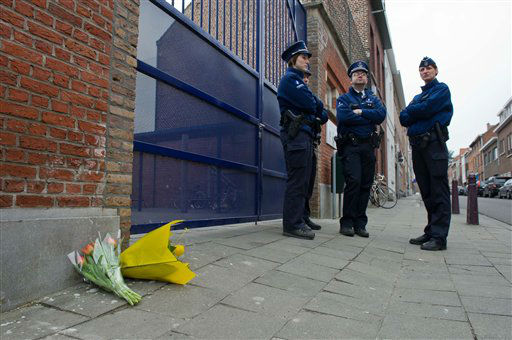 Flowers lie at the gate of the Sint Lambertus School in Heverlee, Belgium, Wednesday, March 14, 2012. A bus carrying Belgian students returning from a ski holiday crashed into a wall in a Swiss tunnel, killing 22 Belgian 12-year-olds and six adults, police said Wednesday. &#40;AP Photo&#47;Geert Vanden Wijngaert&#41; <span class=meta>(AP Photo&#47; Geert Vanden Wijngaert)</span>
