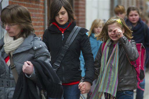 A young girl cries as she and other schoolchildren arrive at the Sint Lambertus School in Heverlee, Belgium, Wednesday March 14, 2012. A bus carrying Belgian students returning from a ski holiday crashed into a wall in a Swiss tunnel, killing 22 Belgian 12-year-olds and six adults, police said Wednesday. &#40;AP Photo&#47;Geert Vanden Wijngaert&#41; <span class=meta>(AP Photo&#47; Geert Vanden Wijngaert)</span>