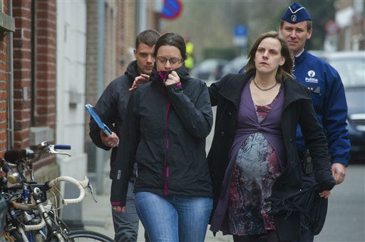 People comfort each other as they arrive at the Sint Lambertus School in Heverlee, Belgium, Wednesday March 14, 2012. A bus carrying Belgian students returning from a ski holiday crashed into a wall in a Swiss tunnel, killing 22 Belgian 12-year-olds and six adults, police said Wednesday. &#40;AP Photo&#47;Geert Vanden Wijngaert&#41; <span class=meta>(AP Photo&#47; Geert Vanden Wijngaert)</span>