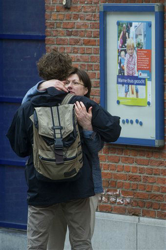 People comfort each other at the Sint Lambertus School in Heverlee, Belgium, Wednesday March 14, 2012. A bus carrying Belgian students returning from a ski holiday crashed into a wall in a Swiss tunnel, killing 22 Belgian 12-year-olds and six adults, police said Wednesday. &#40;AP Photo&#47;Geert Vanden Wijngaert&#41; <span class=meta>(AP Photo&#47; Geert Vanden Wijngaert)</span>