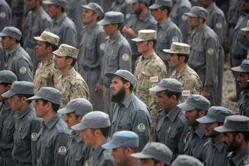 Afghan policemen listen to speeches during a graduation ceremony at a police training center in Guzara, Herat province west of Kabul, Afghanistan, Thursday, March 15, 2012. Around 270 policemen including 27 policewomen graduated after receiving ten weeks of training in Herat. The process of a complete handover to Afghan forces will only be completed in 2014 with the withdrawal of foreign troops from the country. &#40;AP Photo&#47;Hoshang Hashimi&#41; <span class=meta>(AP Photo&#47; Hoshang Hashimi)</span>