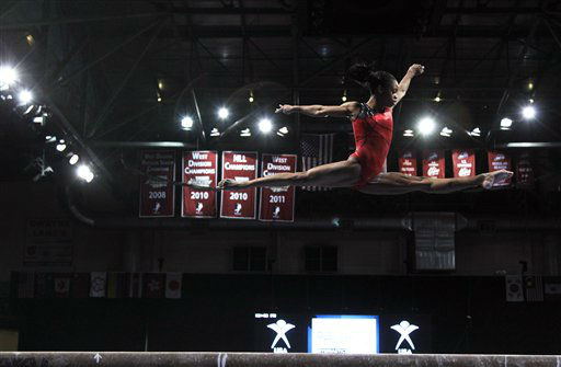 United States gymnast Gabrielle Douglas practices on the balance beam at warm-ups prior to the Pacific Rim Gymnastics Championships in Everett, Wash., Thursday, March 15, 2012. &#40;AP Photo&#47;Ted S. Warren&#41; <span class=meta>(AP Photo&#47; Ted S. Warren)</span>