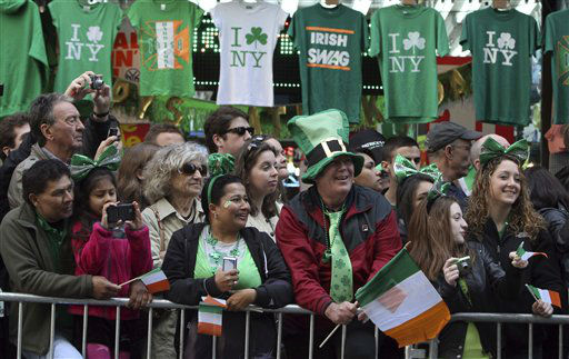 "<div class=""meta ""><span class=""caption-text "">Jim Barber, center, of Philadelphia, watches as marchers make their way up  5th Ave. during the 251st annual St. Patrick's Day Parade,  Saturday, March 17, 2012 in New York.  (AP Photo/Mary Altaffer) (AP Photo/ Mary Altaffer)</span></div>"