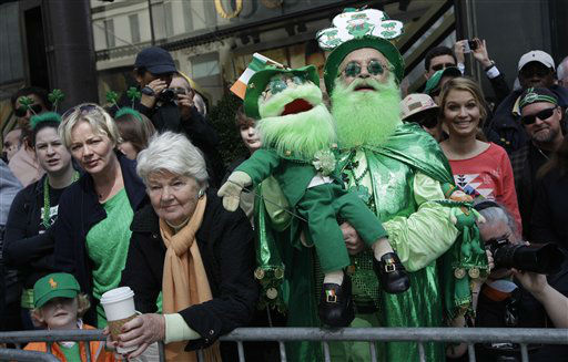 "<div class=""meta ""><span class=""caption-text "">Dennis O'Mally, the self proclaimed ""King of the Leprechaun"" cheers on marchers as they make their way up 5th Ave. during the 251st annual St. Patrick's Day Parade,  Saturday, March 17, 2012 in New York.  (AP Photo/Mary Altaffer) (AP Photo/ Mary Altaffer)</span></div>"
