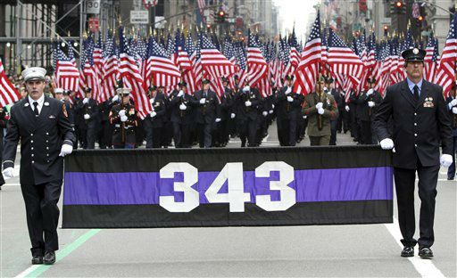 "<div class=""meta ""><span class=""caption-text "">Firefighters carrying 343 American flags representing the firefighters that died during the terrorist attacks on the World Trade Center march up 5th Ave. during the 251st annual St. Patrick's Day Parade,  Saturday, March 17, 2012 in New York.  (AP Photo/Mary Altaffer) (AP Photo/ Mary Altaffer)</span></div>"