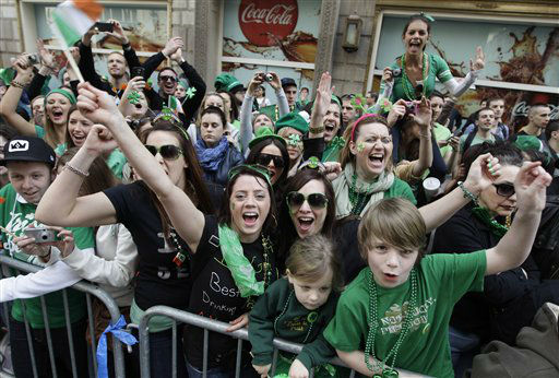 "<div class=""meta ""><span class=""caption-text "">Revelers cheer on marchers as they make their way up 5th Ave. during the 251st annual St. Patrick's Day Parade,  Saturday, March 17, 2012 in New York.  (AP Photo/Mary Altaffer) (AP Photo/ Mary Altaffer)</span></div>"