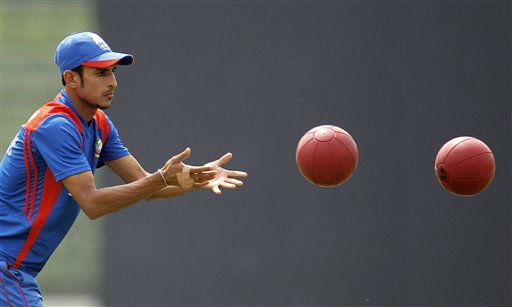 Bangladesh&#39;s Nasir Hossain plays with balls during a training session in Dhaka, Bangladesh, Monday, March 19, 2012. Bangladesh will play Sri Lanka in the sixth cricket match of the Asia Cup Tuesday. &#40;AP Photo&#47;Aijaz Rahi&#41; <span class=meta>(AP Photo&#47; Aijaz Rahi)</span>