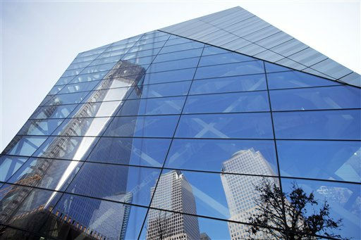 "<div class=""meta ""><span class=""caption-text "">One World Trade Center, left, and nearby buildings, are reflected in the glass facade of the National September 11 Museum, Monday, March 19, 2012 in New York. The tower, now up to the 93rd floor, is expected to be completed in late 2013. (AP Photo/Mark Lennihan) (AP Photo/ Mark Lennihan)</span></div>"